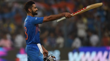 Virat Kohli celebrates after taking India home