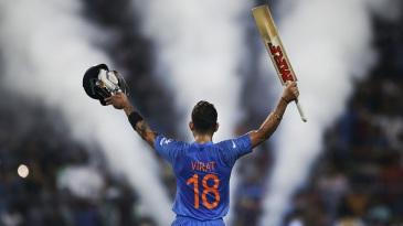 Virat Kohli raises his bat after sealing India's chase