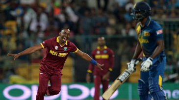 Dwayne Bravo celebrates the dismissal of Angelo Mathews