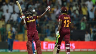Andre Fletcher and Andre Russell celebrate West Indies' win