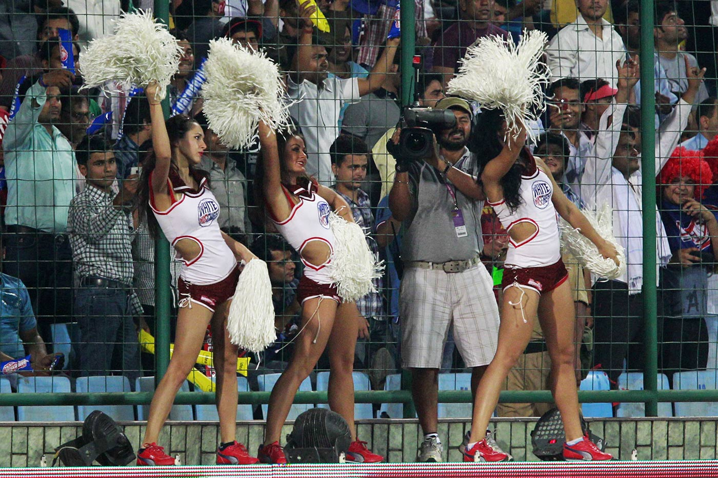 Where's my phone y'all? In the IPL's early years, its cheerleaders strutted their stuff against a backdrop of cameraphone-wielding men