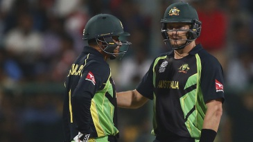 Usman Khawaja and Shane Watson chat during their 62-run opening stand