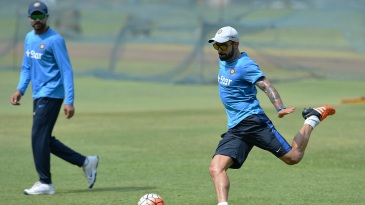 Virat Kohli plays football during India practice