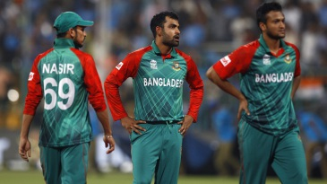 Bangldesh players are dejected after their narrow loss to India