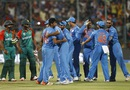 India players celebrate their close win while Shuvagata Hom and Mustafizur Rahman look on, India v Bangladesh, World T20 2016, Group 2, Bangalore, March 23, 2016