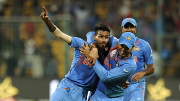 Hardik Pandya is congratulated after defending 11 in the last over