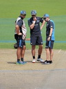 Craig McMillan, Kane Williamson and Mike Hesson inspect the pitch at the Eden Gardens, Kolkata, March 25, 2016