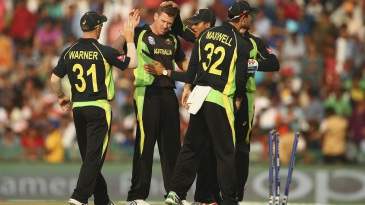 James Faulkner celebrates the wicket of Sharjeel Khan with his team-mates