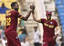 West Indies' spin-duo Samuel Badree and Sulieman Benn celebrate a wicket , Afghanistan v West Indies, World T20 2016, Group 1, Nagpur, March 27, 2016