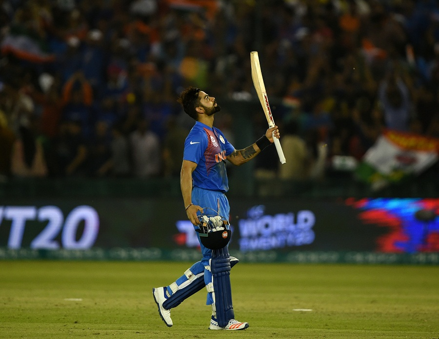 Magical Virat Kohli steers India into World T20 semi-finals