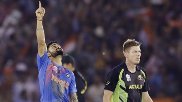 Virat Kohli celebrates after sealing yet another chase for India, while James Faulkner looks dejected