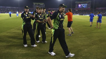 The Australian team clap Shane Watson off the field after his last T20I