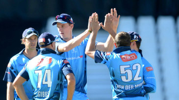 Morne Morkel and other Titans players celebrate a wicket