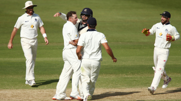 Jon Holland took three wickets in the space of ten overs on the third day
