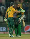 AB de Villiers and Hashim Amla hug each other after taking South Africa home, South Africa v Sri Lanka, World T20 2016, Group 1, Delhi, March 28, 2016