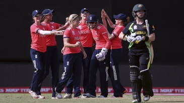 England players celebrate the run out of Meg Lanning