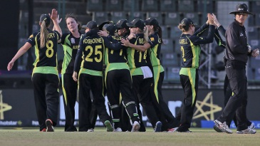 Australia celebrate after making their fourth successive Women's World T20 final