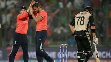 Liam Plunkett is congratulated after picking up Colin Munro