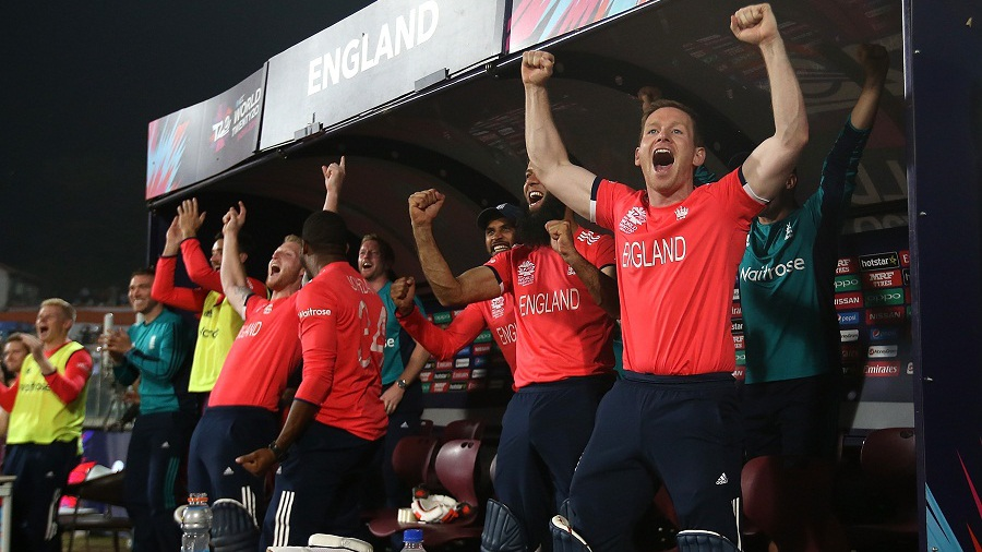 The England dugout erupts with joy after completing a seven-wicket win to reach the final