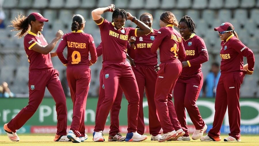 The West Indies team is a gleeful bunch after picking up an early wicket