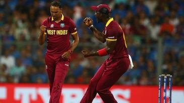 Samuel Badree celebrates the wicket of Rohit Sharma