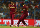 Samuel Badree celebrates the wicket of Rohit Sharma, India v West Indies, World T20 2016, semi-final, Mumbai, March 31, 2016