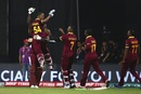 Lendl Simmons is hoisted by his team-mates after his match-winning knock, India v West Indies, World T20 2016, semi-final, Mumbai, March 31, 2016