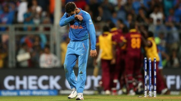 An emotional Virat Kohli walks off the field after India failed to make it to the final