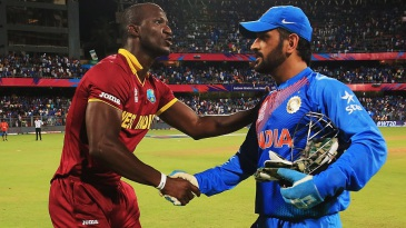 MS Dhoni and Darren Sammy greet each other after the match