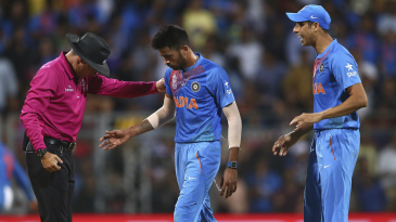 Hardik Pandya retrieves the ball from umpire Richard Kettleborough after the wicket of Lendl Simmons was nullified by a no-ball