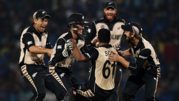 New Zealand players celebrate a wicket with Ish Sodhi
