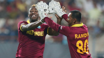 Andre Russell and Denesh Ramdin celebrate
