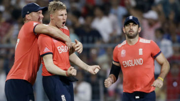 Joe Root celebrates the wicket of Johnson Charles