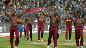 The West Indies team take a lap of honour after their victory