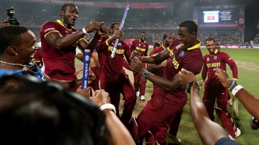 Darren Sammy and Carlos Brathwaite celebrate West Indies' win with the rest of the team