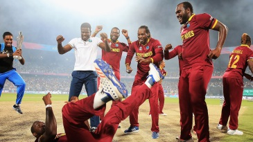 Darren Sammy celebrates the win with a dance even as his mates rejoice