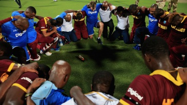 The West Indies team gather in a huddle after winning their second World T20 title