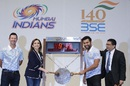 Mumbai Indians owner Nita Ambani and captain Rohit Sharma ring the opening bell at the Bombay Stock Exchange, while Ricky Ponting looks on, Mumbai, April 7, 2016