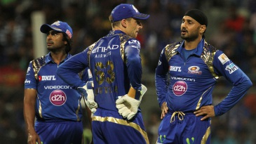 Harbhajan Singh and Jos Buttler get together for a chat even as Ambati Rayudu looks on