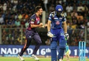 A dejected Jos Buttler leaves the field after being dismissed even as Mitchell Marsh celebrates, Mumbai Indians v Rising Pune Supergiants, IPL 2016, Mumbai, April 9, 2016