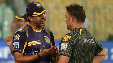 Knight Riders support staff members Wasim Akram and Jacques Kallis talk ahead of the match