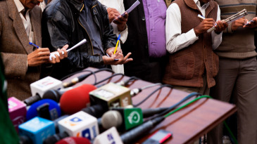 A view of reporters and microphones at a press conference at Gaddafi Stadium in Lahore