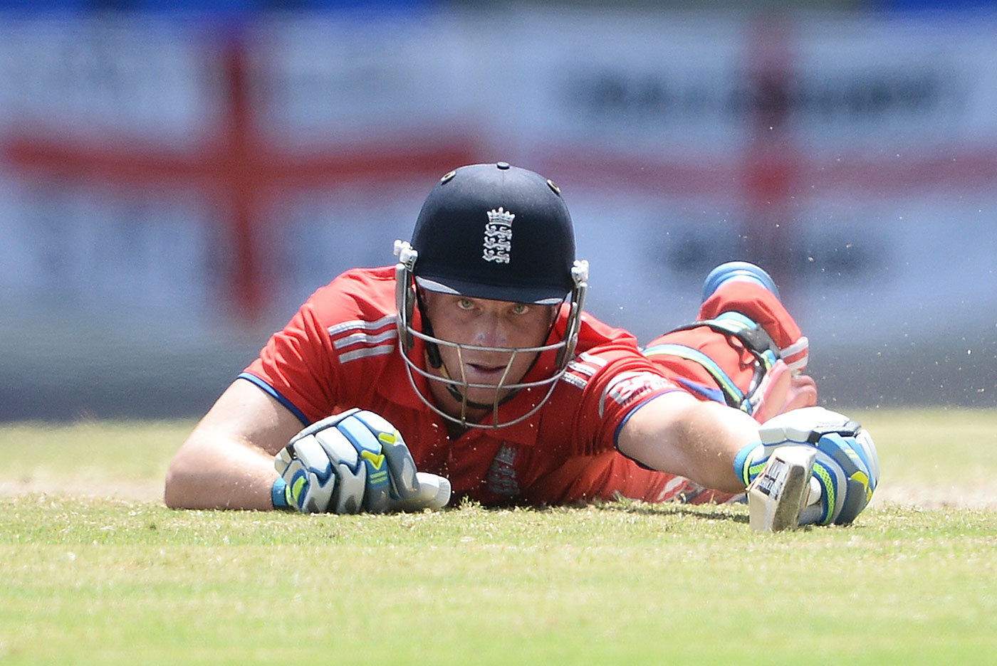 Jos Buttler dives into the crease