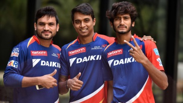 Pawan Suyal, Chama Milind and Khaleel Ahmed pose for a photograph