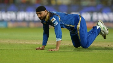 Harbhajan Singh looks on after failing to stop the ball