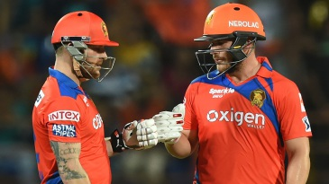 Brendon McCullum and Aaron Finch punch gloves during their 85-run opening stand