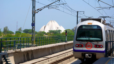 A Delhi Metro train rolls into a station