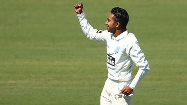 Arjun Nair celebrates a wicket