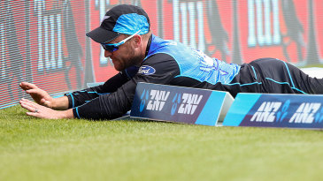 Brendon McCullum slides past the rope and nearly collides with the advertising board
