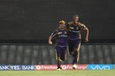 Piyush Chawla and Andre Rusell celebrate after completing an outstanding relay catch, Sunrisers Hyderabad v Kolkata Knight Riders, IPL 2016, Hyderabad, April 16, 2016